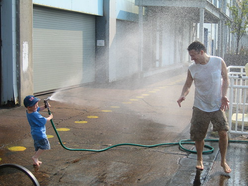 Apparently, city kids rarely get to play with hoses