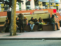 some street kids playing guitar and chilling (Zervas) Tags: street summer people tree green sign dreadlocks square saturated colorful theater guitar candid bricks group busstop chilling pioneercourthousesquare streetmusic dreads pioneer streetkids begging pioneersquare hangingout necktie acrossthestreet sparechange pleasehelp amusingsign streetuniform