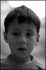 searchin (jam-L) Tags: street portrait bw face algeria eyes dof childrens enfants algerie rue hummingbirdxmas regard algiers alger thecasbah الجزائر blackribbonicon blackandwhitenoiretblanc