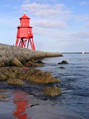 Old lighthouse, South Shields (grytr) Tags: red sea lighthouse reflection topv111 pier seaside harbour olympus tyne explore excellent southshields tyneside groyne interestingness11 c5050z southtyneside 111v1f i500 my100 explore15sep06