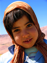 Blue Sky     (Please! Don't Smile.) Tags: blue sky mountain eye nature scarf tooth children persian asia flickr child iran o teeth islam 4th persia east middle tribe  esfahan  islamic bakhtiari     khashayar   gatherin   elyassi abigfave chaharmahal  kid