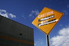 Caution Narrow Roadway (splorp) Tags: blue sky cloud canada building calgary sign yellow metal typography exterior alberta caution signage type narrow roadway