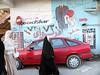Kurdistan, the other Iraq (Chris Kutschera) Tags: woman streetart town veil iraq middleeast hijab advertisement modesty kurdistan khimar