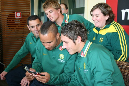 Mark Milligan, Kevin Muscat, Joel Griffiths and I watch my ad
