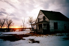 Farmhouse (Mike Bingley) Tags: 2003 pink trees houses sunset sky cloud tree abandoned nature clouds catchycolors skies purple background atmosphere alberta orion ghosttown backlit prairie prairies lethbridge cotcmostfavorited i500 nikonstunninggallery aplusphoto