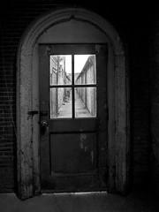 The Old Unlocked Door Trick (nelhiebelv) Tags: easternstatepenitentiary philadelphia pennsylvania monochrome door unlocked