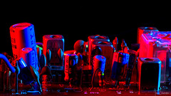 Current Events (iecharleton) Tags: macromondays insideelectronics electronics capacitor resistor transistor components macro closeup sidelight gels coloredlight splitlighting industrial electricity technology blackbackground red blue