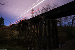 rail bridge iii (Tomás Harrison Fotografía) Tags: longexposure lighttrails d750 nikon traintracks night availablelight landscape austin bridge afnikkor24mmf28d rail atx railroad tx usa