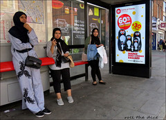 `2344 (roll the dice) Tags: london nw1 camden streetphotography pretty sexy girls muslim burka niqab headscarf veiled mad sad fun funny reaction surreal people fashion busstop chocolate advertisng urban unaware unknown portrait candid strangers travel transport dirty railcard trains eyes mcvities biscuit snack lunch family friends religion culture shops shopping mental emperorpenguin uk art classic canon tourism tourists asian hot cold weather sunny lookalike
