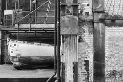 Urban Sailing.... (markwilkins64) Tags: drainpipes boat bricks scaffolding decay urban uk oxotower london securitycamera