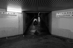 Into the dark cold night (gambajo) Tags: 1year1town1lens brühl blackandwhite blackwhite black white public outdoors people walk man tunnel underpass subway tram dark night city urban x100s fujix100s fujifilmx100s mensch mann unterführung strasenbahn