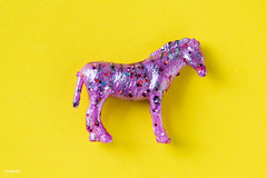 Aerial view of horse figurine toy in a colorful background (rawpixel.com) Tags: aerial animal background bedazzled bling childhood closeup colorful decor decorated decoration effects equestrian fashion figure flatlay funky glitter horse isolated model name object plastic safari sequin shimmer style stylish toy yellowbackground