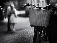 parked bike (Sandy...J) Tags: atmosphere atmosphäre blackwhite bw bike bicycle fotografie fahrrad photography street streetphotography sw schwarzweis strasenfotografie stadt city germany deutschland noir urban olympus monochrom blur blurred people