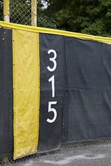 Foul line (milepost430media.com) Tags: stadium baseball field sport game dslr canon 5d markiv 315 feet measure fence foul post yellow