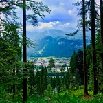 Forest framed view of the river Inn valley, Tyrol, Austria thumbnail