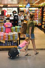 Hitching a ride (radargeek) Tags: den denver airport travel colorado travelers traveler kid kids children mom daughter carryon sandals suitcase