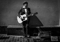 the Liverpool Busker (Chilanga Cement) Tags: fuji fujifilm xseries x100f 100f fujix100f bw blackandwhite monochrome liverpool liverpoolstreetphotography beatlesday beatles music