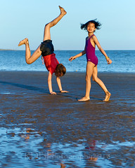 Skylne Trip to 金海沙滩 Gymnasts 26 (C & R Driver-Burgess) Tags: young teen preteen girl beach sand wet ripples sunset sea reflection two couple pair togs bathing suit bathers black shorts orange teeshirt purple bare feet long golden hair short slender slim tall asian caucasian scenery horizon bridge cartwheel headstand elegant energetic beautiful happy together watch muddy sandy poise skill