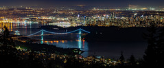 Brilliant Metropolis (Sworldguy) Tags: vancouver cypress lights harbour nightscene night wideangle lionsgatebridge downtown city skyline water sky landscape bay buildings view pano panoramic