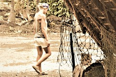 Place of refuge (thomasgorman1) Tags: park site historic cultural woman nikon tourism island hawaii sacred net roof trees candid walking sepia