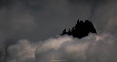 Castle of Heaven (Frédéric Fossard) Tags: grain texture silhouette altitude montagne mountain sky mood moodysky nuages clouds mist storm fog brume brouillard orage alpes hautesavoie cimes crêtes arêtes mountainpeak mountainridge picdemontagne chamonix massifdumontblanc aiguillesdechamonix dark lumière dramaticsky aiguillesrocheuses merdenuage