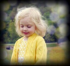 Autumn when she was little (markdavidsmom) Tags: bokeh spring easter girl preschooler portrait daughter cardigan sweater blonde yellow daisies