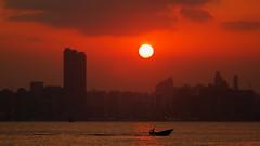 Heading Home (Wilson Au | 一期一会) Tags: fujifilm xe2 smcpentaxm135mmf35 asahi manualfocus sunset hongkong sea boat silhouette city buildings backlight evening