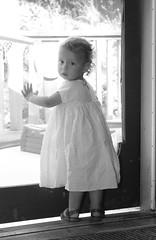 Margaux wanting out. (KaseyEriksen) Tags: child girl daughter granddaughter sister blackwhite bw