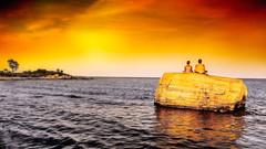Meditation at Sunset (Alan Charles) Tags: ct connecticutshore hammonassetbeachstatepark hammonassetstateparkmeigspoint meditation meigspoint seascape beach ocean red rockyshoreshore sea shore sunset
