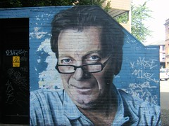 Manchester street art == TONY WILSON.  (A LEGEND) HACIENDA, FACTORY RECORDS, ITV/BBC JOURNALIST (rossendale2016) Tags: lenses lens photographic photo hacienda electricity sign out keep death danger storey multi station sub substation wall park car busy city quarter northern square stevenson remembered fascinating popular central centre iconic icon order new cd division joy monday's happy promoter manager bands music radio television bbc tv granada 24 film people party hour four twenty coogan steve born salford pendleton hospital hope groups pop various nightclub havienda records factory legend wilson tony art street manchester