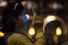 phone glow (andy_8357) Tags: sony a6000 low light canon fd 50mm f14 wide open ilcenex ilce6000 alpha 6000 mirrorless varanasi india aarti puja candid portrait portraiture street photography travel ghats ghat ganga ganges mother phone glow bokeh outdoors girl hindu hinduism family high iso headband earrings indian asia asian south uttar pradesh