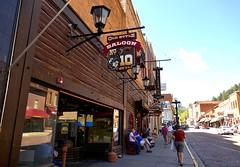 A street in Deadwood, South Dakota (ali eminov) Tags: deadwood southdakota streets shops saloons oldstylesaloon signs people catherine