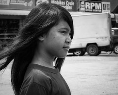Concentration (Beegee49) Tags: street girl filipina child car parking bacolod city philippines