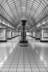 Designed In 30s Built In The 40s (tcees) Tags: gantshill undergroundstn londontransport tube pillars lights uplighter artdeco seats map wall tiles ceiling arch x100 fujifilm finepix bw mono monochrome blackandwhite centralline roundel urban