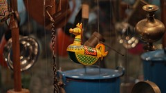 The wooden horse. (vignesha4) Tags: woodenhorse horse yellow art hanging sony alpha streetphotography minimalism minimalistic minimalart 50mm minolta50 colors museum artgallery india incredibleindia chennai tamilnadu tamil