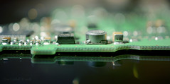 On the Waterfront! (Elisafox22 catching up again ;o)) Tags: elisafox22 sony nex6 e30mm f35 macro macrolens hmm macromondays bokeh insideelectronics green circuitboard kindle black reflections electronics component lensflare tabletop indoors elisaliddell©2018