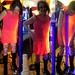 20171102 2354 - 3-month HRT post-thrifting fashion show - blacklight orange dress - 06542377-54.27-23.55.13 (triptych)