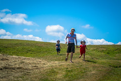 Emmanuel and Lise and Matthieu running along the fields in Normandy France.