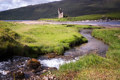 Ardvreck Castle II (Paul C Stokes) Tags: ardvreckcastle ardvreck castle ruins old lochassynt loch assynt ruined 1590 clan macleod sutherland scotland history northcoast north coast 500 nc nc500 light shade tide tidal stream grass grassy stone stonewall wall ripple ripples waves sonya7r2 sony a7r2 a7rii landscape zeiss 1635 1635mm