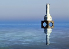 Lighthouse Reflecting in Lake Michigan in Port Washington, Wi (marymorano) Tags: lighthouses water lakemichigan greatlakes reflections calmness scenicoutdoors horizon manmade monuments outdoorphotography nature day afternoon seagulls birds wildlife daytime calm peaceful still