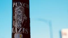 Punch Nazis (dangaken) Tags: chicago summer summer2018 chi il illinois windycity fuji fujixt10 fujifilm fujinon sticker nazi richardspencer punchnazis nazis hitler trump lightpole pole dgaken dangaken photobydangaken