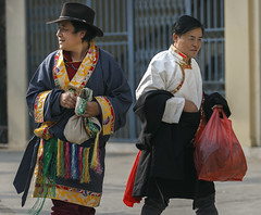 Two gentleman dressed in Tibetan traditional dress carrying incense(sang) as offerings at a ceremony during Losar third day. (Tenzin Samphel) Tags: men menwear menfashion menstyles tibetanmen tibetan chupa tibetanwear tibetans menswear menhats mens tibetanphotographer beautyoftibet colorsoftibet eventphotographer tenzinsamphelphotography kathmandu nepal