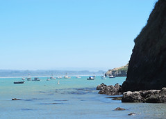 Fishing In The Bay (Kabbri) Tags: panorama sea shore travel water beach tourism sky buoy calm blue ocean seaweed rocky rock cliff cliffs bay fishing boats beautiful seascape landscape vacation nature tourist coast view boat summer stone coastline