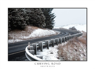 Curving road through snow covered hills