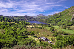 Llyn Gwynant (Howie Mudge LRPS BPE1*) Tags: llyngwynant snowdonia nationalpark outside outdoors greatoutdoors bright sunny summer day sky bluesky clouds whispyclouds lake fields trees farm water vista gwynedd wales cymru uk travel ngc nationalgeographic sony sonya7ii sonyalpha minoltarokkormc35mmf28 polarizer polariser landscape nature