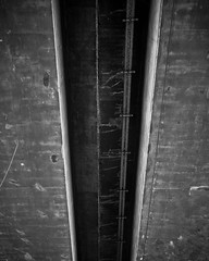 Black and white concrete shapes and texture. (pedferr) Tags: lines pattern cement artistic shapes abstract city virgoshapes texture vertical california urban contrast structure construction symmetry outdoors pipe architecture monochrome antique blackandwhite bridge concrete usa unitedstatesofamerica