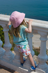 Looking out over the sea (ellieupson) Tags: spain nerja costadelsol child girl hat sea sun holiday vacation summer blue pink