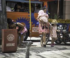 Street Corner (Beegee49) Tags: street corner woman mother child hat filipina jeepney passengers bananas bacolod city philippines
