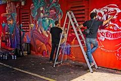 Art on a Red Wash (garryknight) Tags: sony a6000 on1photoraw2018 london creativecommons ccby30 alpha art street streetart graffiti red wash man artist paint spray can