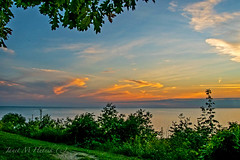 Afterglow (jmhutnik) Tags: ohio lakeerie willowick color goldenhour lake clouds